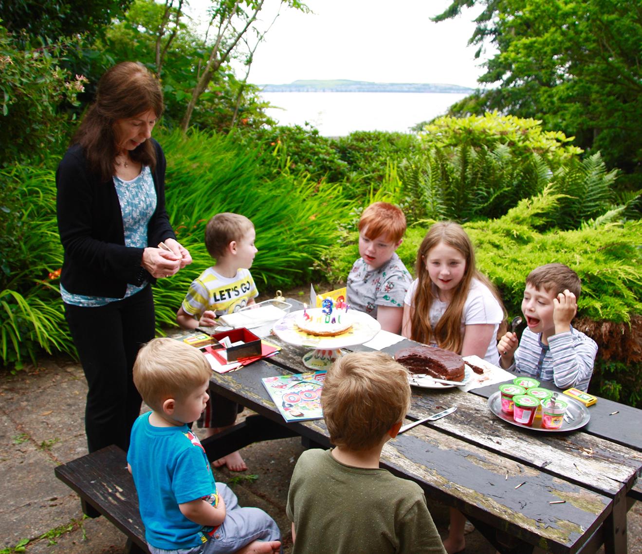 Tricia with her six grandchildren in her garden 2016
